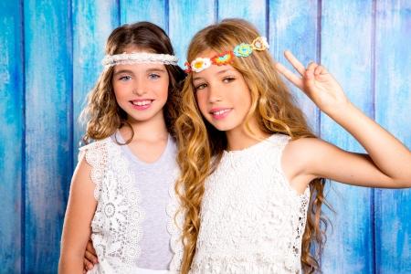 vintage children: Children friends beautiful girls hippie retro style smiling together on blue wood