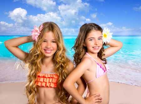 children friends girls happy together in tropical beach vacation photo