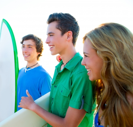 Teenager surfers group happy in beach shore high key photo