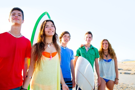 Teenager surfers boys and girls group happy in beach shore high key photo