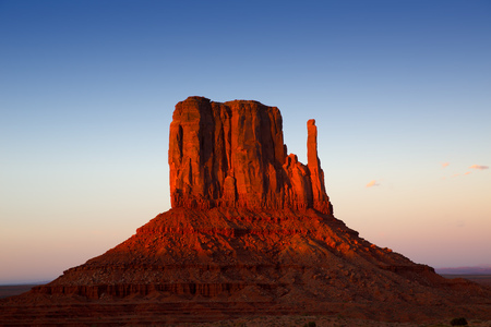 Monument Valley West Mitten at sunset blue sky Utah Stock Photo