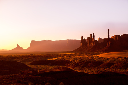 national monuments: Monument Valley Totem Pole sunrise at national Park Utah