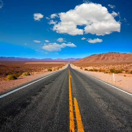 mojave desert: Never ending road to Death Valley California sunny desert Stock Photo