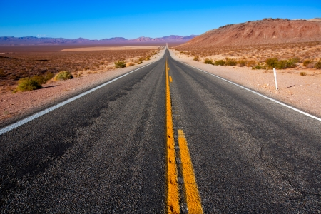 never: Never ending road to Death Valley California sunny desert Stock Photo