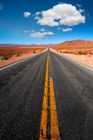 desert highway: Never ending road to Death Valley California sunny desert Stock Photo