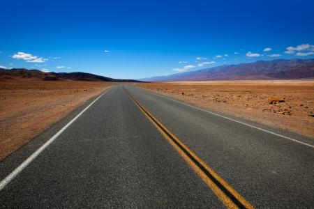 Deserted Route 190 highway in heart of Death Valley California