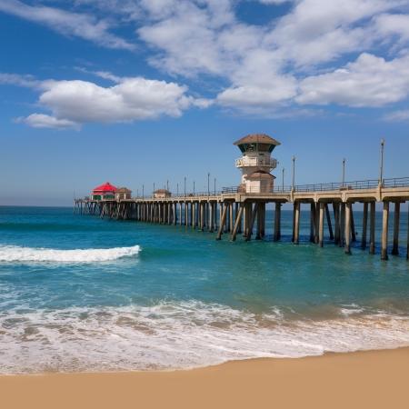 huntington beach: Huntington beach Surf City USA pier view with sand and waves