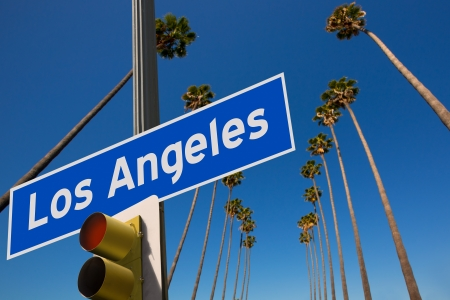 california state: LA Los Angeles palm trees in a row typical California with road sign photo mount Stock Photo