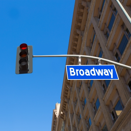 semaphore: Broadway street Los Angeles Road sign in redlight improved with illustration