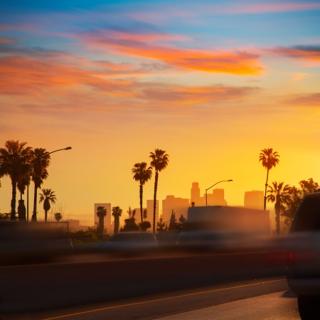 california state: LA Los Angeles sunset skyline with traffic California from freeway