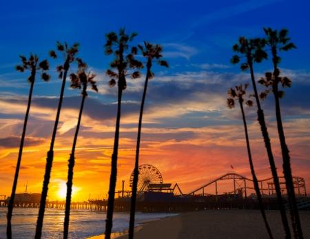 monica: Santa Monica California sunset on Pier Ferrys wheel and reflection on beach wet sand