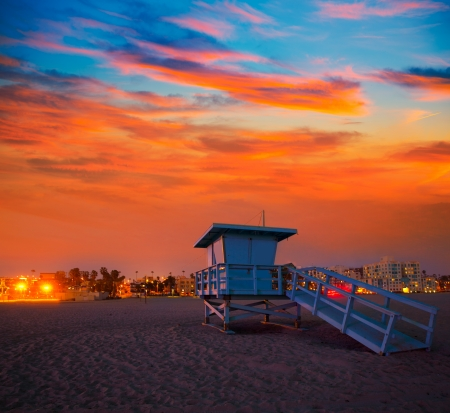 Santa Monica California sunset lifeguard tower and glowing city in USA