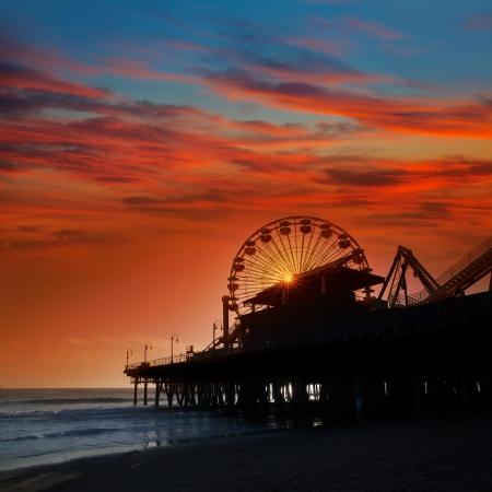 ferris: Santa Monica California sunset on Pier Ferrys wheel  in orange sky