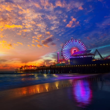 water wheel: Santa Monica California sunset on Pier Ferrys wheel and reflection on beach wet sand