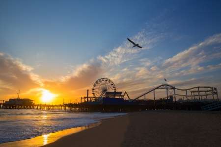 Santa Monica California sunset on Pier Ferrys wheel and reflection on beach wet sand photo