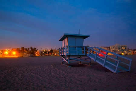 Santa Monica California sunset lifeguard tower and glowing city in USA photo