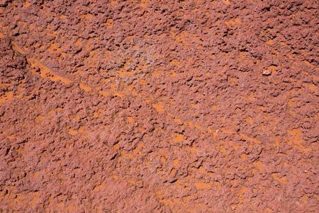 rock formation: Arizona red stone detail with orange desert sand near Colorado River Stock Photo