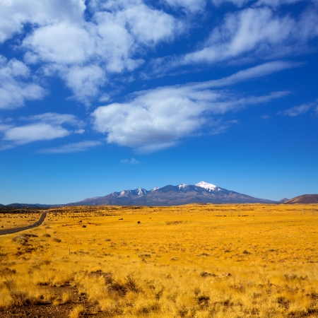 Arizona Highway 89 US with view of snowed mountains in Humphreys peak near Flagstaff