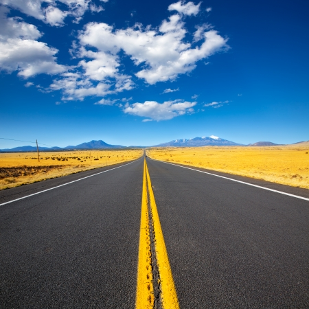 desert highway: Arizona Highway 89 US with view of snowed mountains in Humphreys peak near Flagstaff