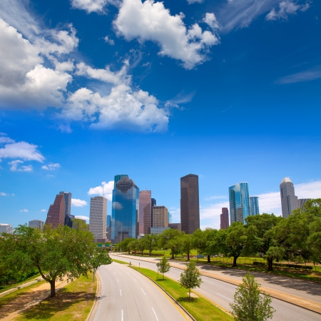 houston: Houston Texas Skyline with modern skyscapers and blue sky view from road