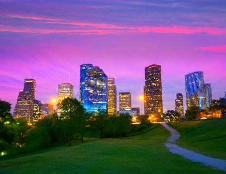 Houston Texas modern skyline at sunset twilight from park lawn photo