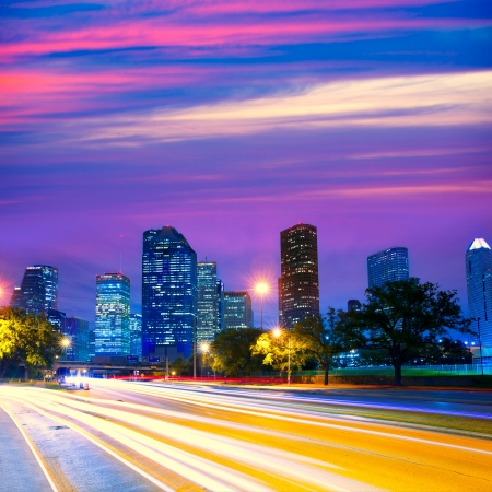 Houston Texas modern skyline at sunset twilight with traffic headlights lights trace photo