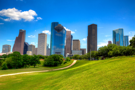 houston: Houston Texas Skyline with modern skyscapers and blue sky view from park lawn
