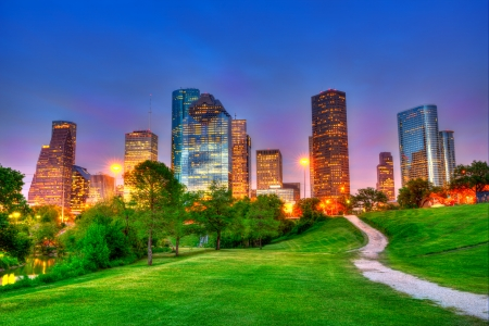 Houston Texas modern skyline at sunset twilight from park lawn HDRI