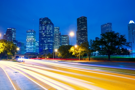 Houston Texas modern skyline at sunset twilight with traffic headlights lights trace Stock Photo