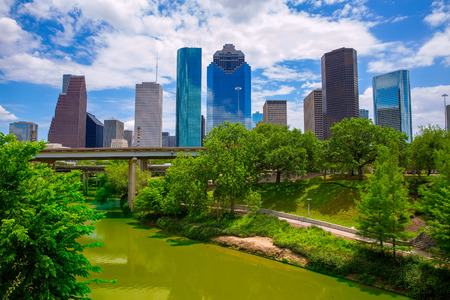Houston Texas Skyline with modern skyscapers and blue sky view from park river US