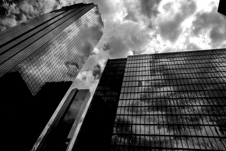 rise and shine: Black and white Houston Texas downtown mirror buildings detail