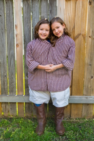 dido: twin girls fancy dressed up pretending be siamese with his father shirt