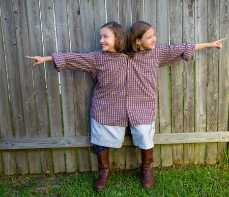 dido: twin girls fancy dressed up pretending be siamese with his father shirt pointing finger