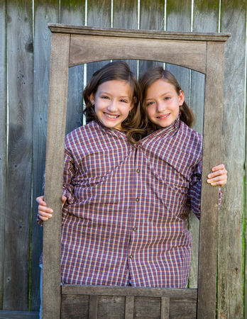 dido: twin girls fancy dressed up pretending be siamese with dad shirt playing with grunge border frame