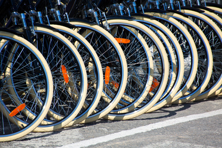 pedal: Bicycles front wheel tyres in a row detail