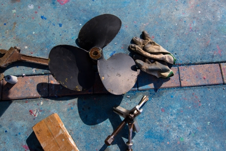 boat propeller improvement tools and gloves during a repair work photo