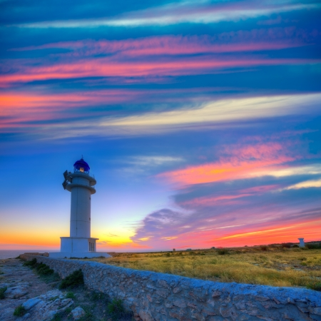 Barbaria Berberia Cape Lighthouse Formentera at sunset in Balearic Islands photo