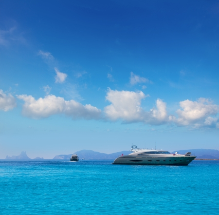 es: Formentera boats with Ibiza Es Vedra in Balearic islands