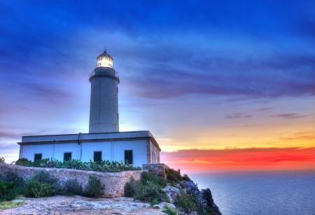 La Mola Cape Lighthouse Formentera at sunrise in Balearic Islands photo