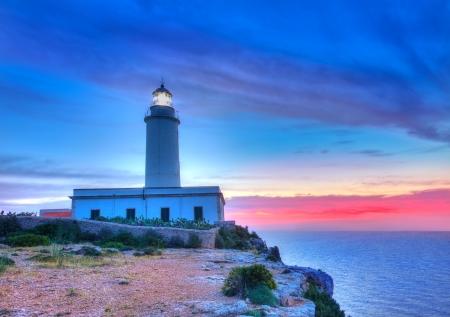 formentera: La Mola Cape Lighthouse Formentera at sunrise in Balearic Islands