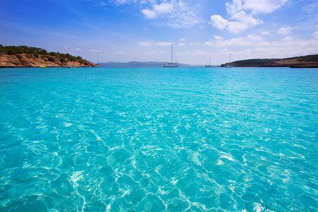 formentera: Ibiza Cala Bassa beach with turquoise Mediterranean sea at Balearic Islands