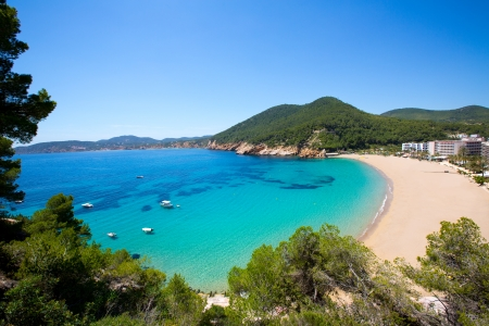 Ibiza caleta de Sant Vicent cala San vicente beach san Juan at Balearic Islands of spain photo