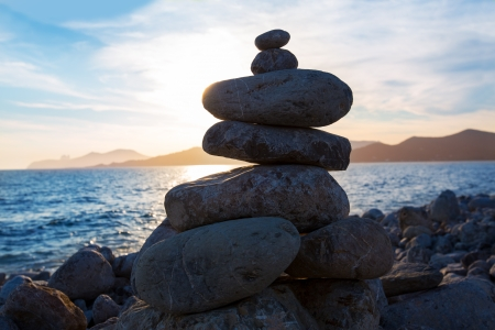 Ibiza Cap des Falco sunset with desire stones at the beach in Sant Josep Balearic Islands Stock Photo