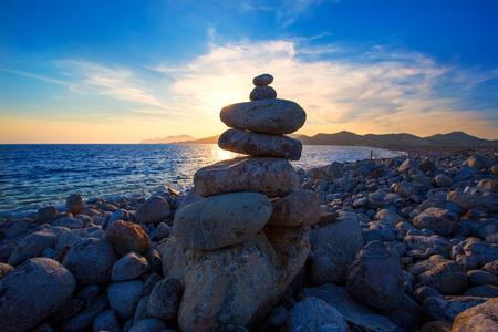 josep: Ibiza Cap des Falco sunset with desire stones at the beach in Sant Josep Balearic Islands Stock Photo