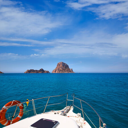 es: Boating in Ibiza with Es Vedra y Vedranell islands in balearic Mediterranean Stock Photo