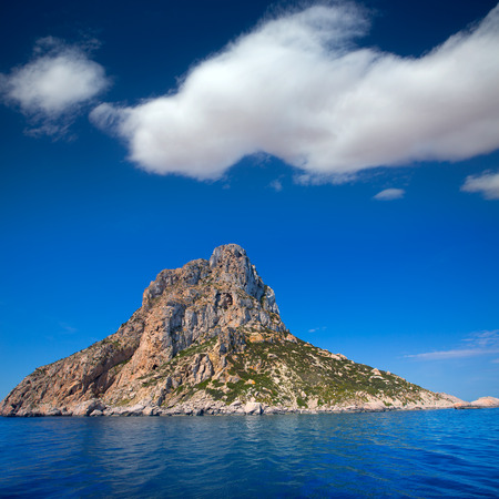 Es Vedra island of Ibiza close view from boat in Mediterranean Balearic Islands photo