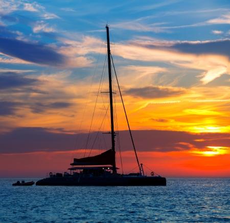 balearic: Ibiza san Antonio Abad de Portmany catamaran sailboat sunset with in Balearic islands of spain
