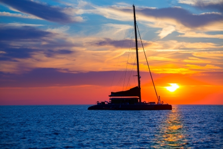 ibiza: Ibiza san Antonio Abad de Portmany catamaran sailboat sunset with in Balearic islands of spain