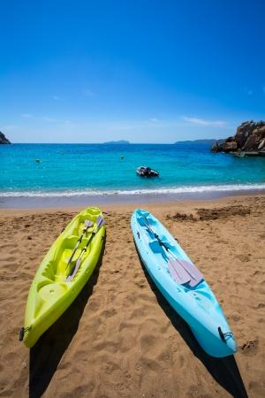 watersports: Ibiza cala Sant Vicent beach with Kayaks san Juan at Balearic Islands of spain Stock Photo