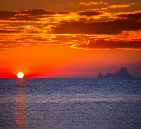 Ibiza sunset Es Vedra view from Formentera la Savina red orange sky photo